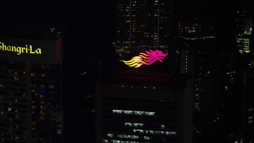 Rooftop Logo on a Hong Kong Island Skyscraper at Night Aerial Stock Footage | SS01_0222