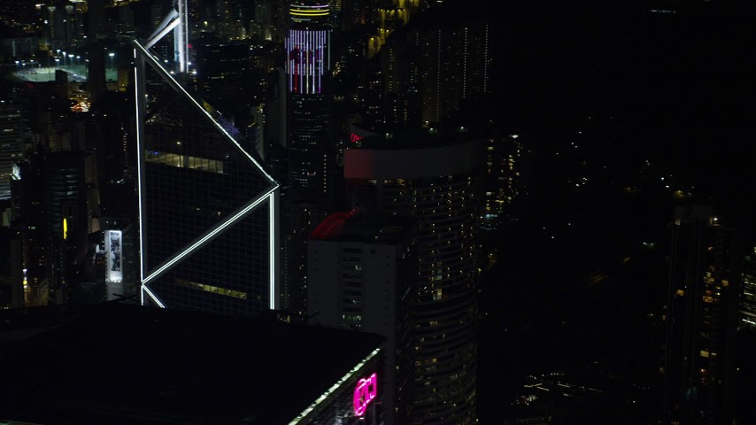 Orbit Bank of China Tower to Reveal a Pair of High-rises at Night on Hong Kong Island Aerial Stock Footage | SS01_0227