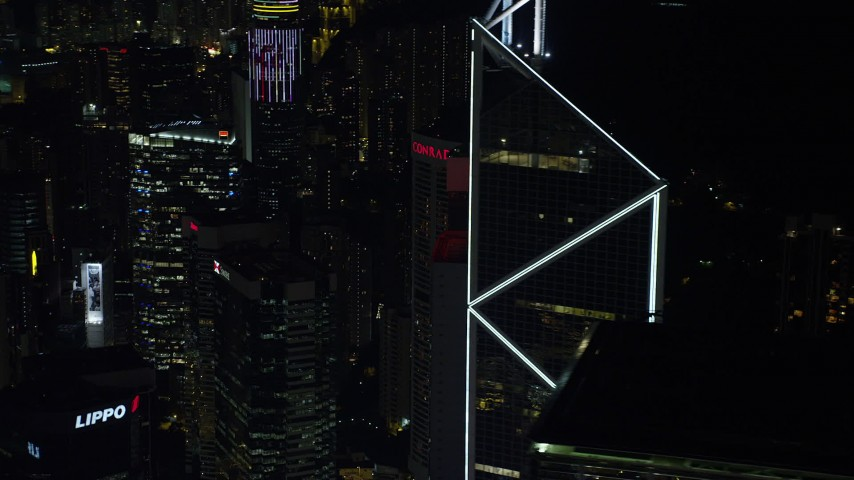 5K stock footage aerial video orbit Bank of China Tower to reveal a pair of high-rises at night on Hong Kong Island, China Aerial Stock Footage | SS01_0227