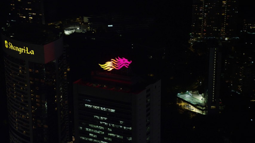 Flyby Dragon Logo on Hong Kong Island High-rise Rooftop at Night Aerial Stock Footage | SS01_0229
