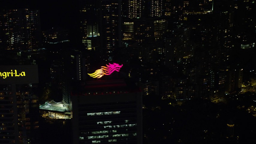 5K stock footage aerial video flyby dragon logo on Hong Kong Island high-rise rooftop at night, China Aerial Stock Footage | SS01_0229