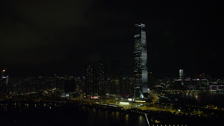 5K stock footage aerial video of International Commerce Centre skyscraper at night in Kowloon, Hong Kong, China Aerial Stock Footage | SS01_0230