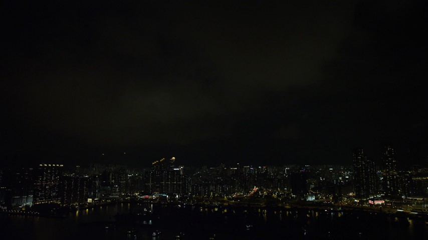 5K stock footage aerial video of lightning flashes above Kowloon waterfront apartment buildings at night, China Aerial Stock Footage | SS01_0231