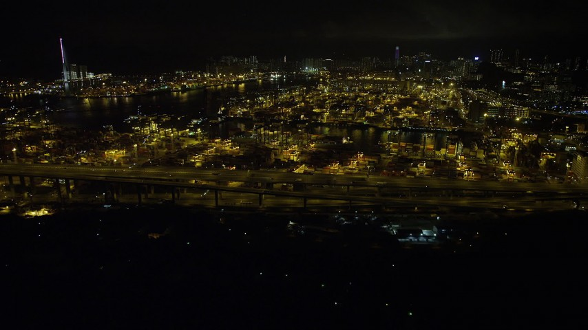 Approach and Fly Over Containers and Cranes at the Port of Hong Kong at Night Aerial Stock Footage | SS01_0232