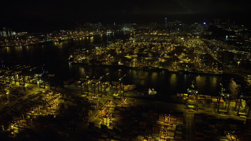 Fly Over Cargo Ships and Cranes at the Port of Hong Kong at Night Aerial Stock Footage | SS01_0233