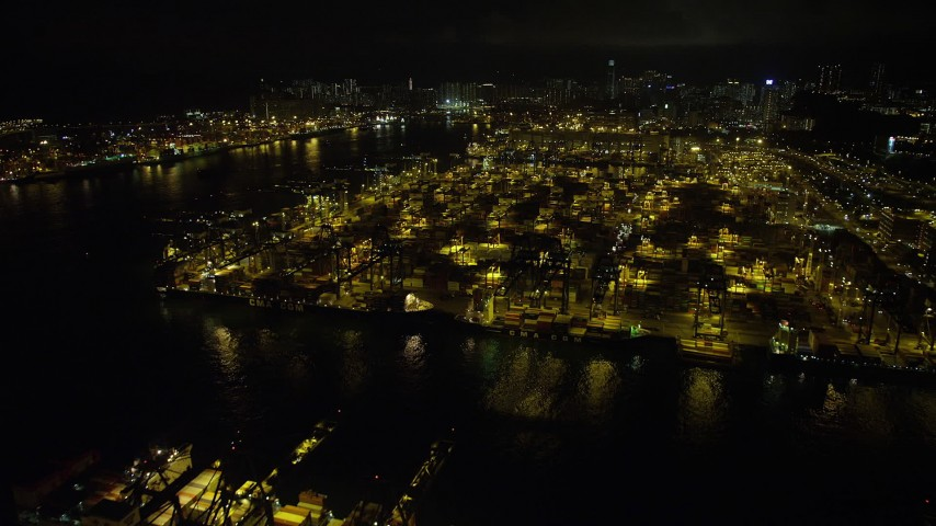5K stock footage aerial video fly over cargo ships and cranes at the Port of Hong Kong at night, China Aerial Stock Footage | SS01_0233