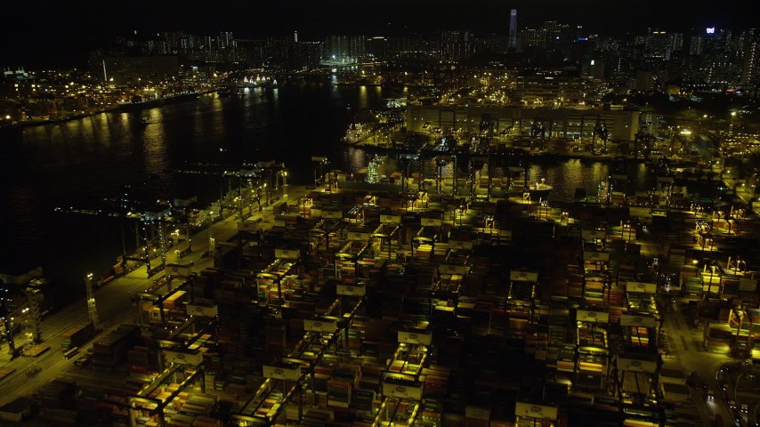Fly Over Rows of Shipping Containers at Night at the Port of Hong Kong Aerial Stock Footage | SS01_0235