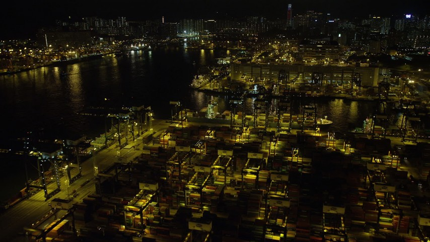 5K stock footage aerial video fly over rows of shipping containers at night at the Port of Hong Kong, China Aerial Stock Footage | SS01_0235