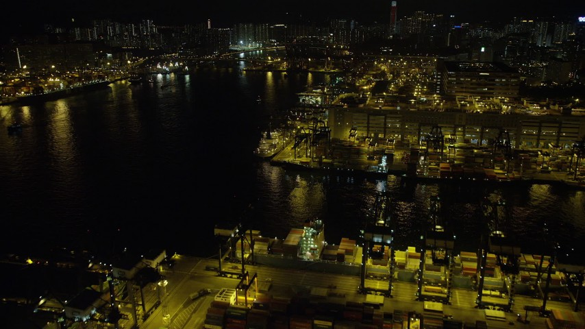 Fly Over Ships Docked under Cranes at Night At the Port of Hong Kong Aerial Stock Footage | SS01_0236