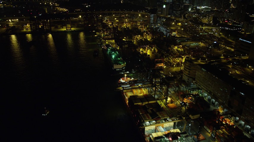 Flyby a Pair of Cargo Ships Docked at the Port of Hong Kong at Night Aerial Stock Footage | SS01_0238