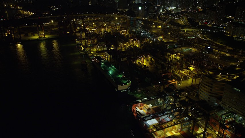 5K stock footage aerial video flyby a pair of cargo ships docked at the Port of Hong Kong at night, China Aerial Stock Footage | SS01_0238