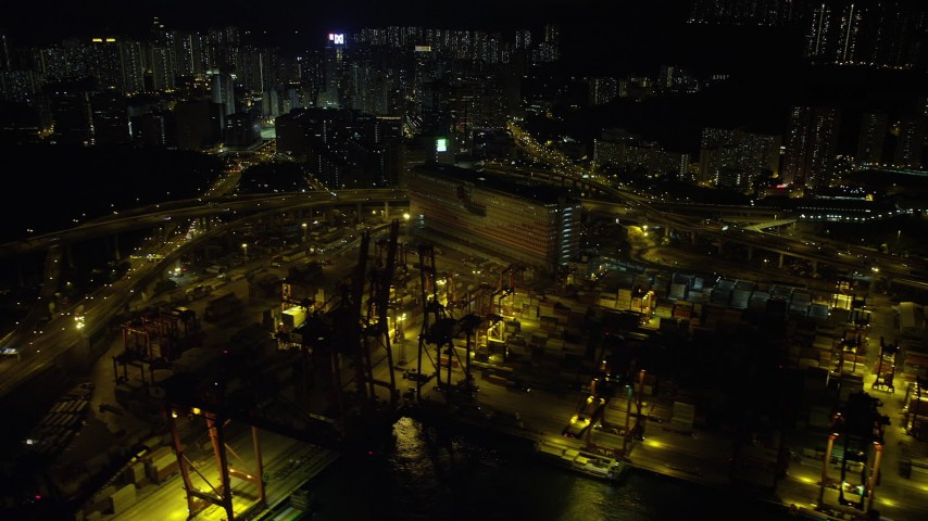 5K stock footage aerial video flyby cargo cranes and wide streets at the Port of Hong Kong at night, China Aerial Stock Footage SS01_0240 | Axiom Images