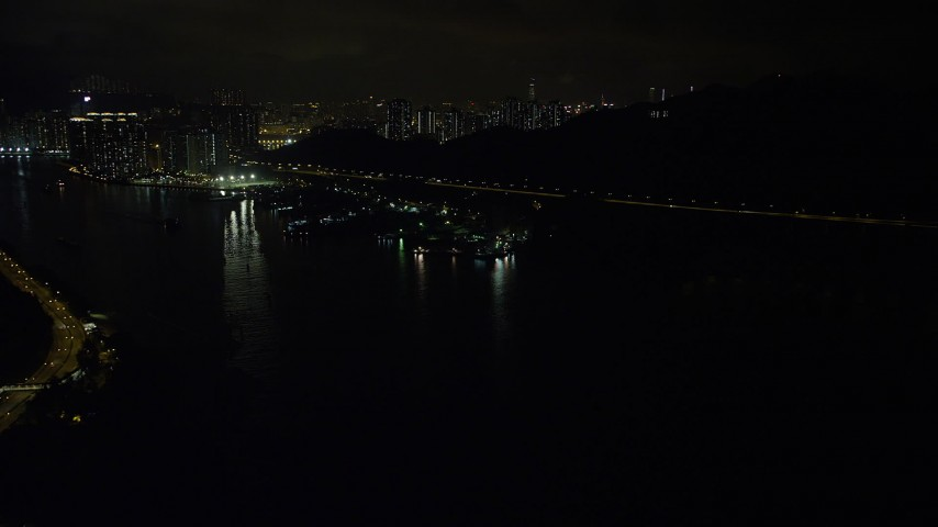 5K stock footage aerial video approach small piers and warehouses on Rambler Channel at night in Hong Kong, China Aerial Stock Footage | SS01_0250