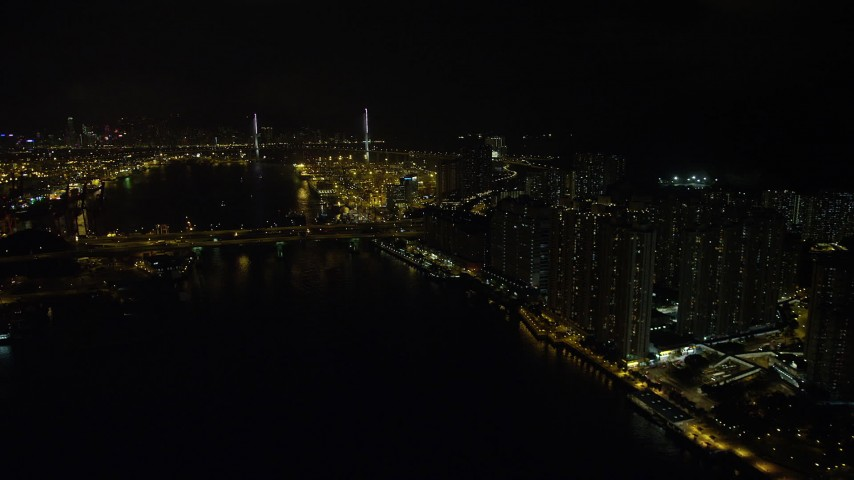 5K stock footage aerial video follow Rambler Channel by Tsing Yi Island to approach Stonecutters Bridge at night, China Aerial Stock Footage   SS01_0259