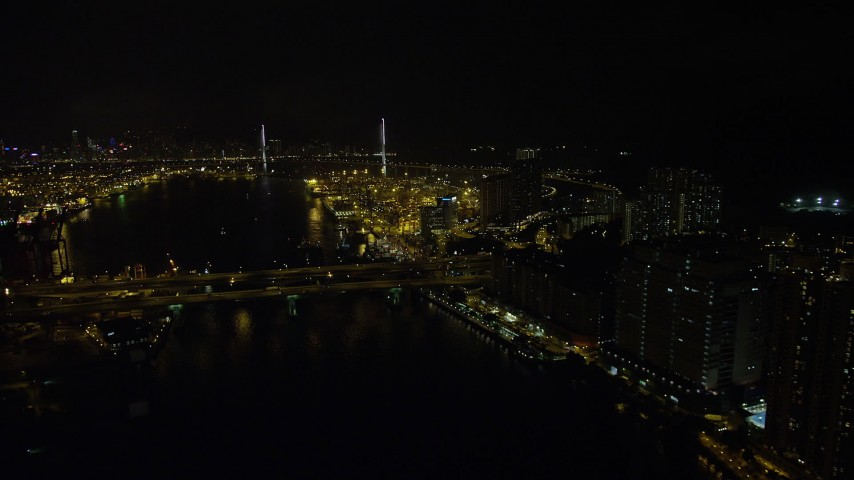 Fly Over Rambler Channel at Night to Approach Stonecutters Bridge and Port of Hong Kong Aerial Stock Footage | SS01_0260