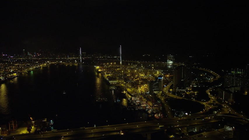 Follow Rambler Channel by the Port to Hong Kong at Night to Approach Stonecutters Bridge Aerial Stock Footage | SS01_0261