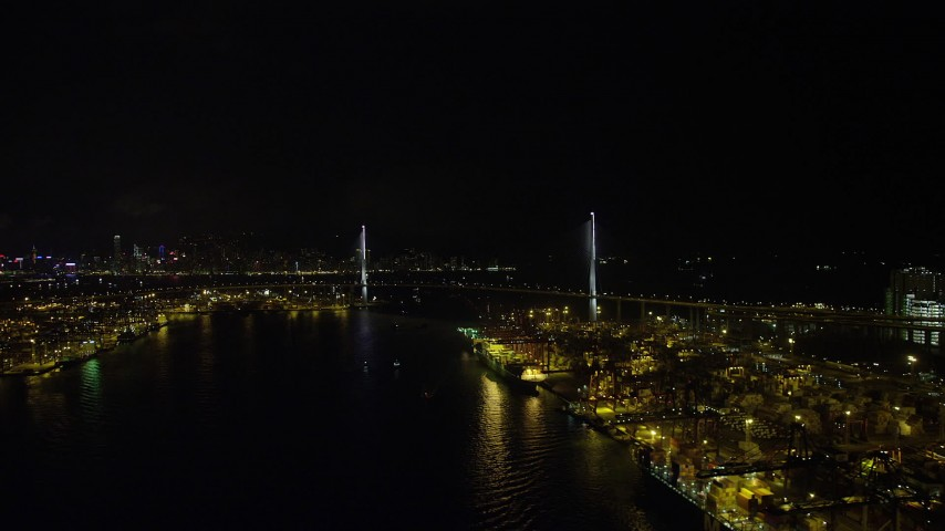 Approach Stonecutters Bridge from Rambler Channel through Port of Hong Kong at Night Aerial Stock Footage | SS01_0263