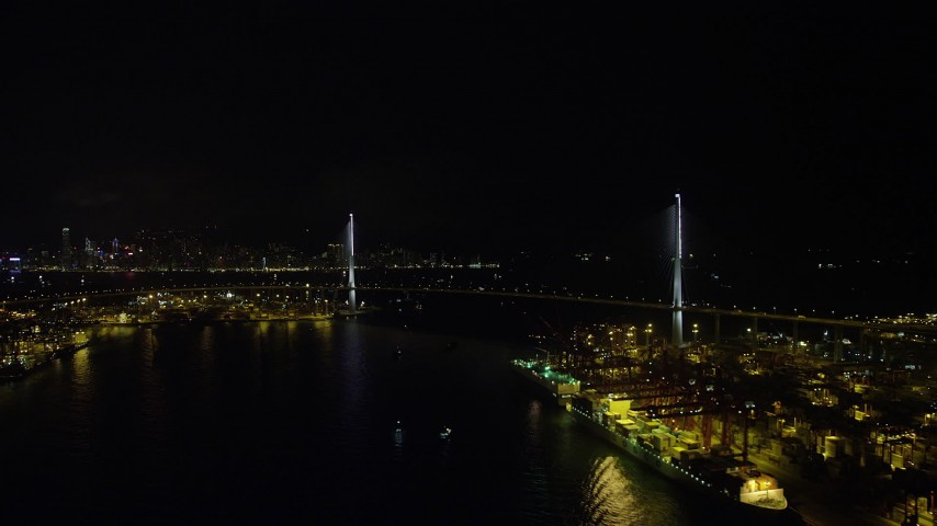 5K stock footage aerial video approach the Stonecutters Bridge at night from Rambler Channel in Hong Kong, China Aerial Stock Footage | SS01_0264