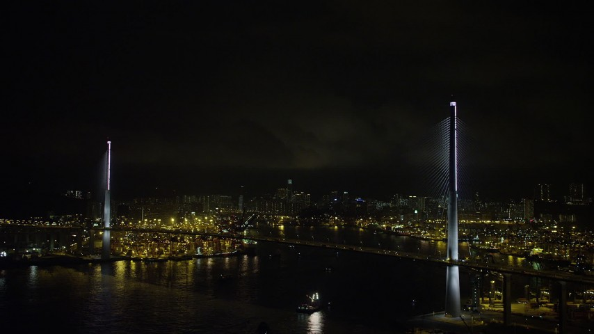 Stonecutters Bridge at Night in Hong Kong with Lightning Flashes Overhead Aerial Stock Footage | SS01_0269