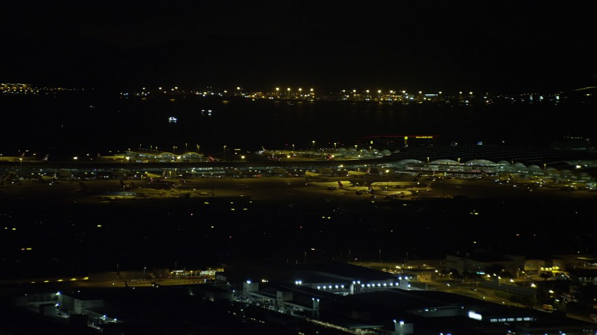 5K stock footage aerial video of airliners and terminals at the Hong Kong International Airport at night, China Aerial Stock Footage | SS01_0278