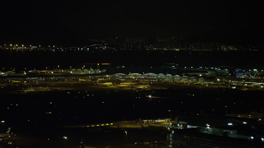 5K stock footage aerial video of airliners parked at the terminal at Hong Kong International Airport at night, China Aerial Stock Footage | SS01_0279