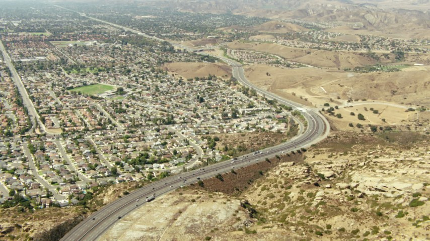 1080 stock footage aerial video follow the 118 freeway to neighborhoods in Simi Valley, California Aerial Stock Footage | TS01_002