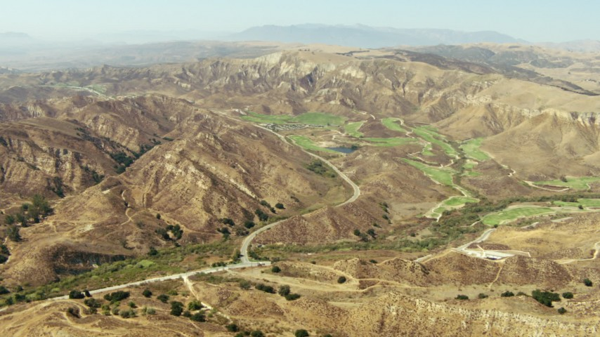 1080 stock footage aerial video of a golf course and brown hills in Simi Valley, California Aerial Stock Footage | TS01_007