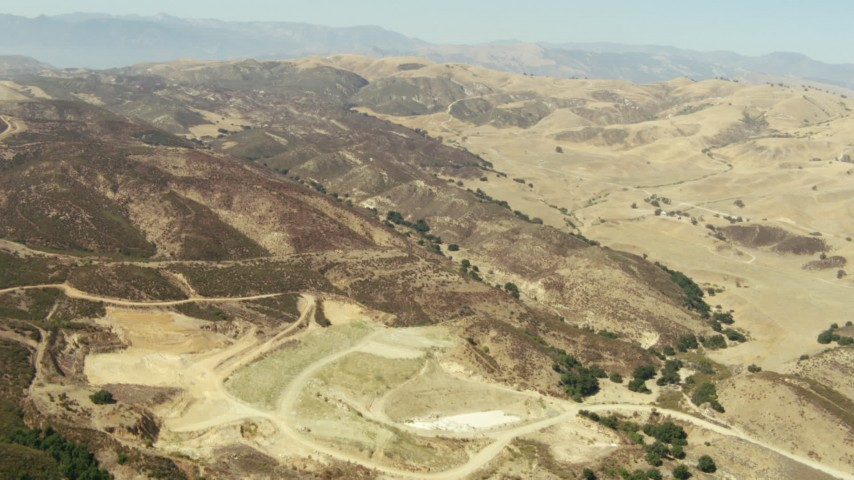 1080 stock footage aerial video of flying over barren hills and valleys in Simi Valley, California Aerial Stock Footage | TS01_011