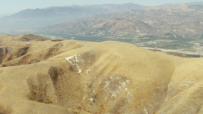 1080 stock footage aerial video of fly over hills to reveal farmland in Piru, California Aerial Stock Footage | TS01_013