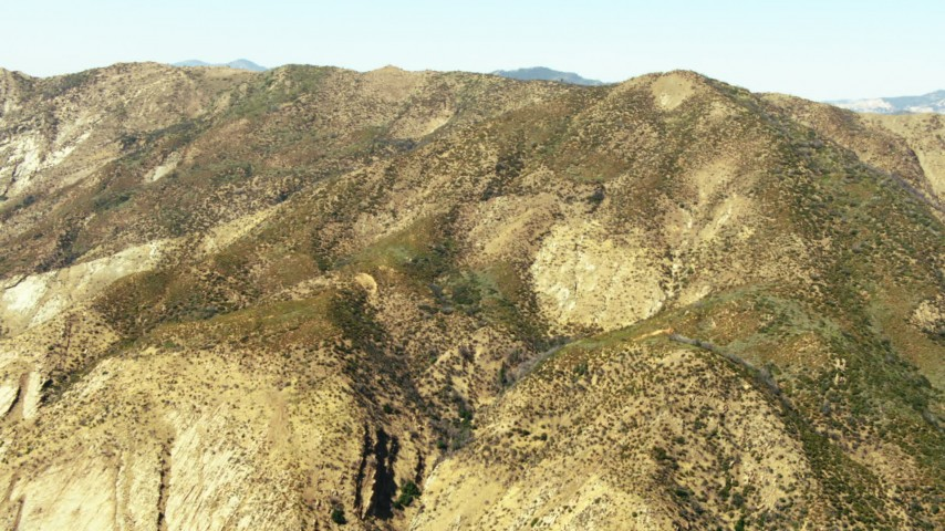 1080 stock footage aerial video tilt to a view of a mountain ridge summit in Los Padres National Forest, California Aerial Stock Footage | TS01_026