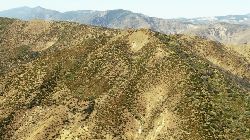 1080 stock footage aerial video of a mountain ridge and a range in the distance, Los Padres National Forest, California Aerial Stock Footage | TS01_027