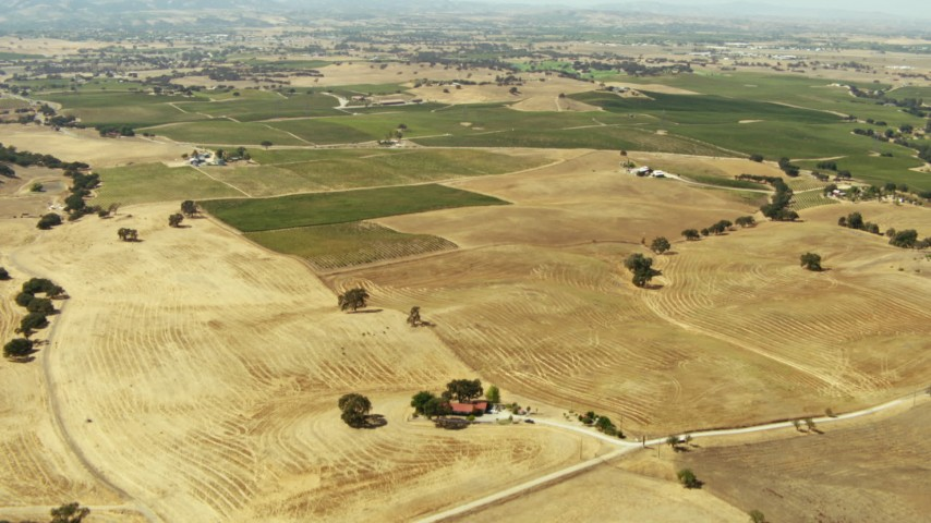 1080 stock footage aerial video of farmland and houses in Paso Robles, California Aerial Stock Footage | TS01_079