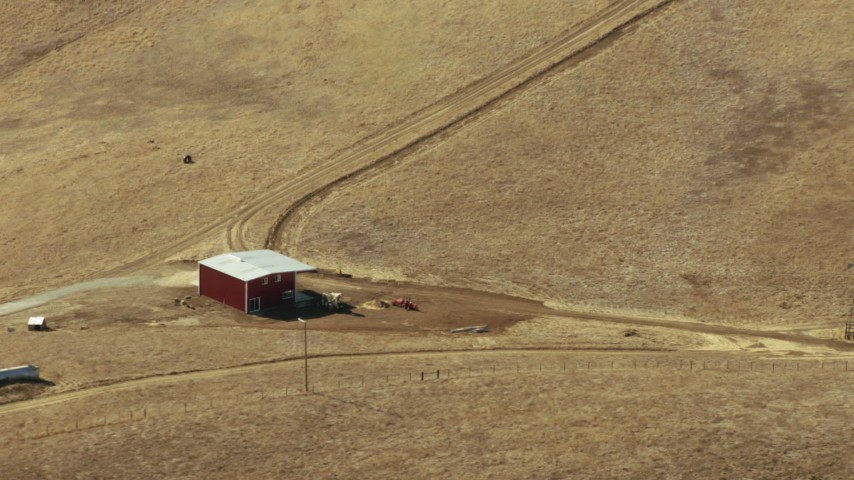 1080 aerial stock footage video of of a lone red barn in Paicines, California Aerial Stock Footage   TS01_114