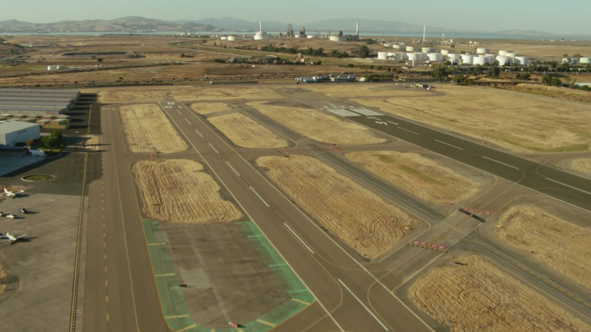 1080 stock footage aerial video of lifting off from airport near refinery in Pacheco, California Aerial Stock Footage   TS01_145