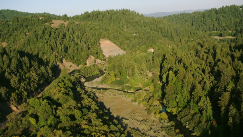 1080 stock footage aerial video follow Russian River to reveal a vineyard in Guerneville, California Aerial Stock Footage   TS01_218