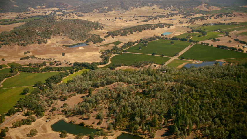 1080 stock footage aerial video pan across ponds and vineyards in Pope Valley, California Aerial Stock Footage | TS01_246
