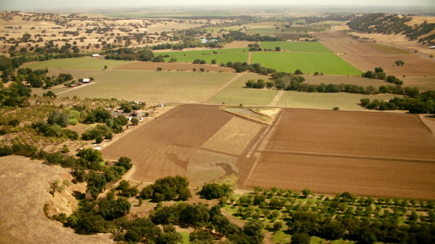 1080 stock footage aerial video of flying over farm fields and barns in Capay, California Aerial Stock Footage TS01_265 | Axiom Images