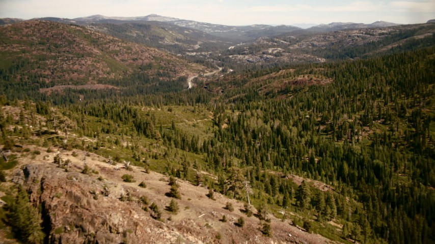 1080 stock footage aerial video of mountain highway seen while flying over trees in Sierra Nevada Mountains, California Aerial Stock Footage | TS01_293