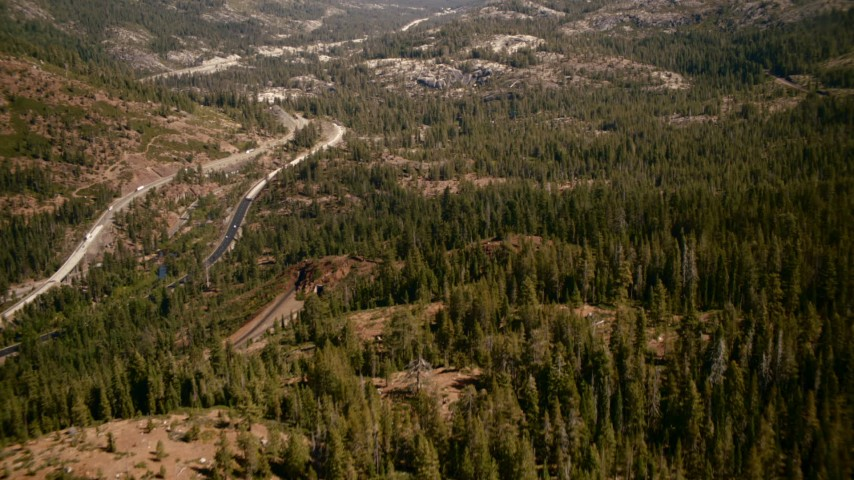1080 stock footage aerial video flyby train tracks, tilt to reveal mountain highway, Sierra Nevada Mountains, California Aerial Stock Footage | TS01_294