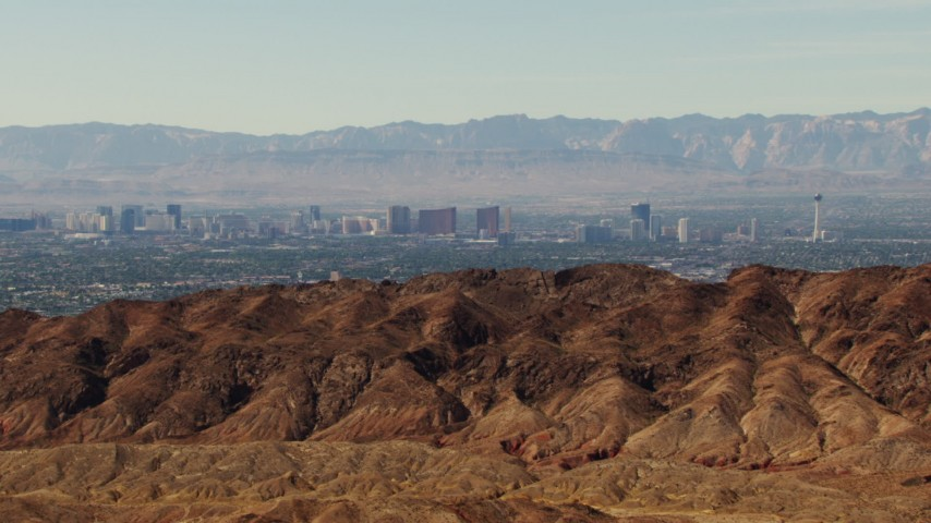 1080 stock footage aerial video approach the Frenchman Range with Las Vegas Strip in the background, Nevada Aerial Stock Footage | TS02_27
