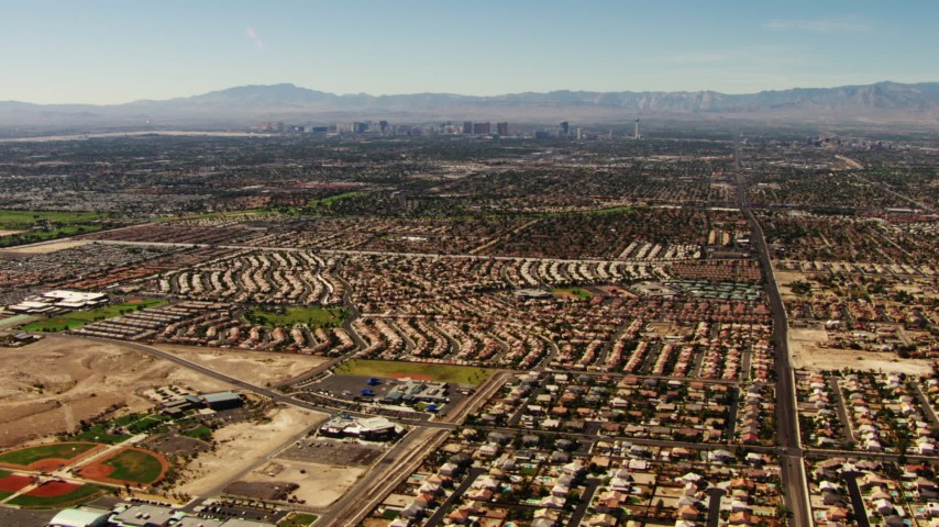 1080 aerial video pan across homes in East Las Vegas to reveal the Las Vegas Strip, Nevada Aerial Stock Footage TS02_31