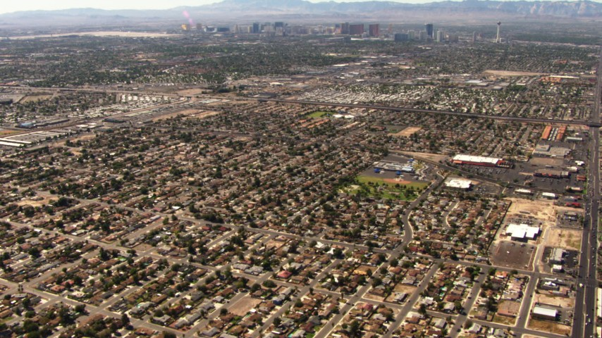 1080 aerial video tilt from neighborhoods in East Las Vegas to reveal the Las Vegas Strip, Nevada Aerial Stock Footage | TS02_34