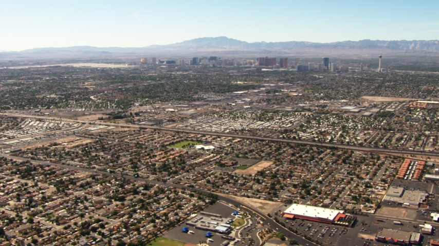 1080 aerial video fly over East Las Vegas homes toward the Las Vegas Strip, Nevada Aerial Stock Footage | TS02_35