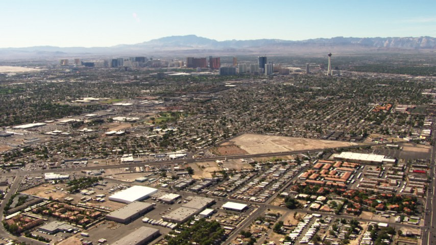 1080 stock footage aerial video tilt from East Las Vegas homes to reveal the Las Vegas Strip, Nevada Aerial Stock Footage | TS02_36