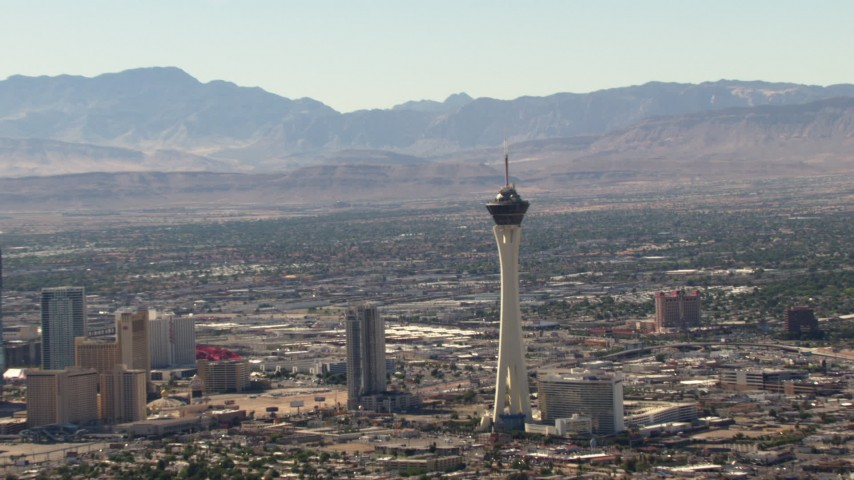 1080 stock footage aerial video zoom from a view of the top of Stratosphere to reveal Las Vegas Strip, Nevada Aerial Stock Footage | TS02_37