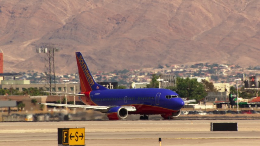 1080 stock footage aerial video of a Southwest airliner at McCarran International Airport, Las Vegas, Nevada Aerial Stock Footage | TS02_48