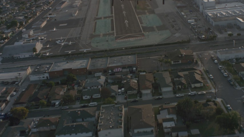 Lear Jet landing gear while taking off from Hawthorne Municipal Airport, California Aerial Stock Footage | WA001_001