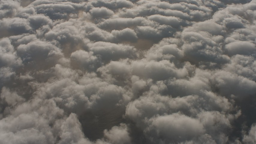 Reverse view of the Pacific Ocean visible through breaks in the cloud cover, Southern California Aerial Stock Footage | WA001_005