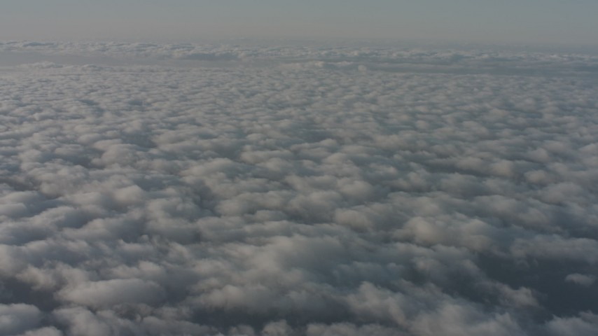 Tilt up and down on a wide expanse of cloud cover, Southern California Aerial Stock Footage WA001_007 | Axiom Images