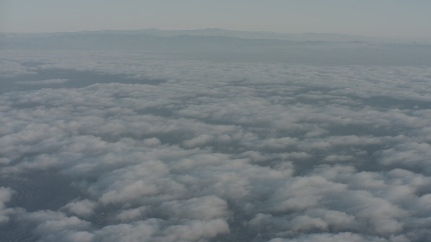 4K stock footage aerial video fly over clouds toward distant mountain ridges in Ventura County, California Aerial Stock Footage | WA001_011